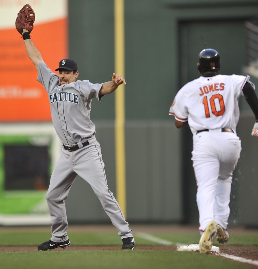 ASSOCIATED PRESS Baltimore Orioles  Adam Jones runs to first as Seattle Mariners first baseman Casey Kotchman comes off the bag for the throw from third baseman Jose Lopez in the first inning in a baseball game Monday, Aug. 16, 2010 in Baltimore. Jones was safe on the play.