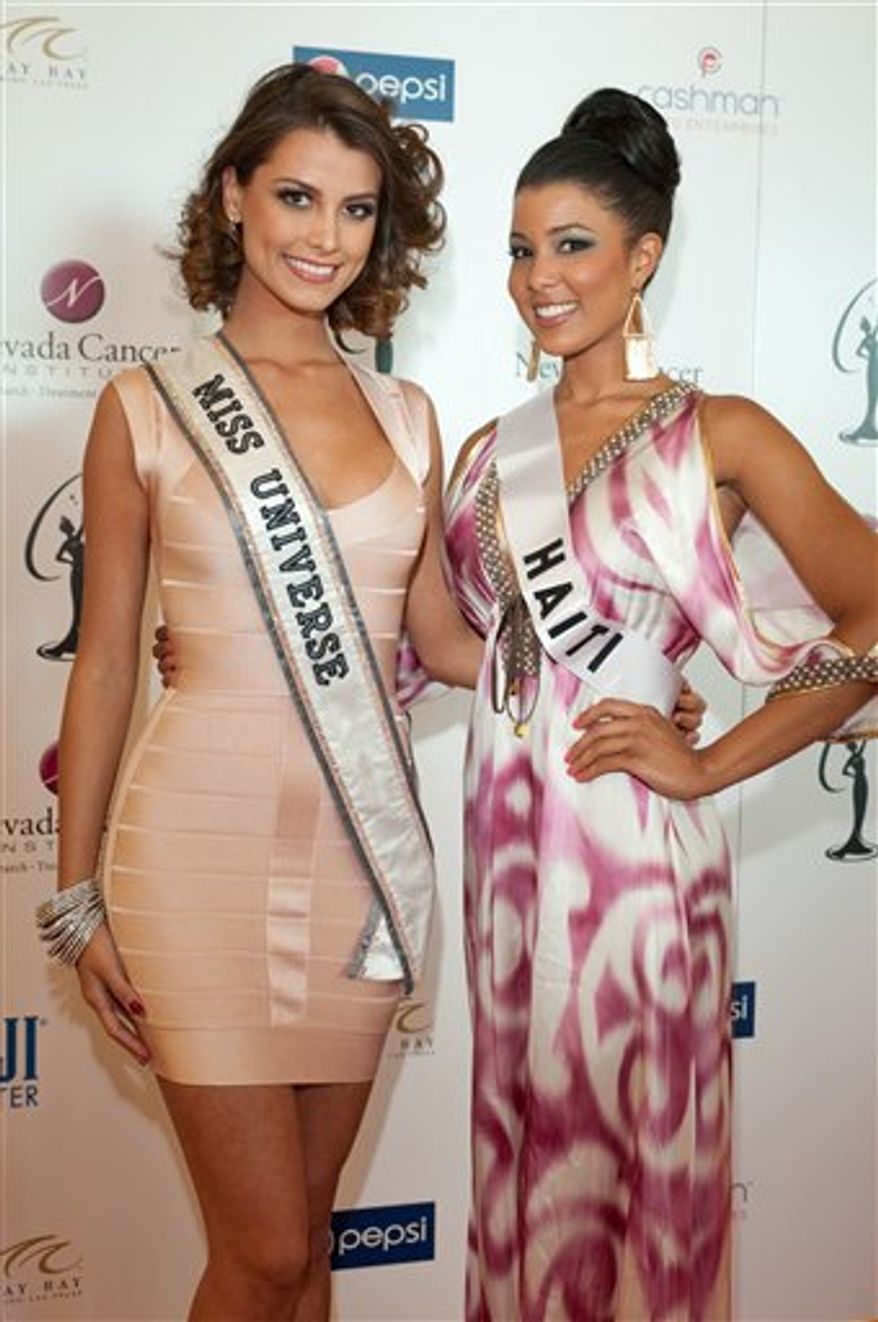 In this image provided by the Miss Universe Organization, Stefania Fernandez, Miss Universe 2009, and Sarodj Bertin, Miss Haiti 2010, arrive at the Miss Universe National Gift Auction to Benefit Nevada Cancer Institute at Mandalay Bay Resort and Casino in Las Vegas, Nevada on Saturday, Aug. 14, 2010. The Miss Universe 2010 competition that will air live  Aug. 23, 2010. (AP Photo/Miss Universe Organization)