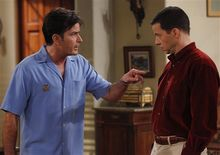 """In this publicity image released by CBS, Charlie Sheen, left, and Jon Cryer are shown in a scene from, """"Two and a Half Men.""""  (AP Photo/CBS, Greg Gayne)"""