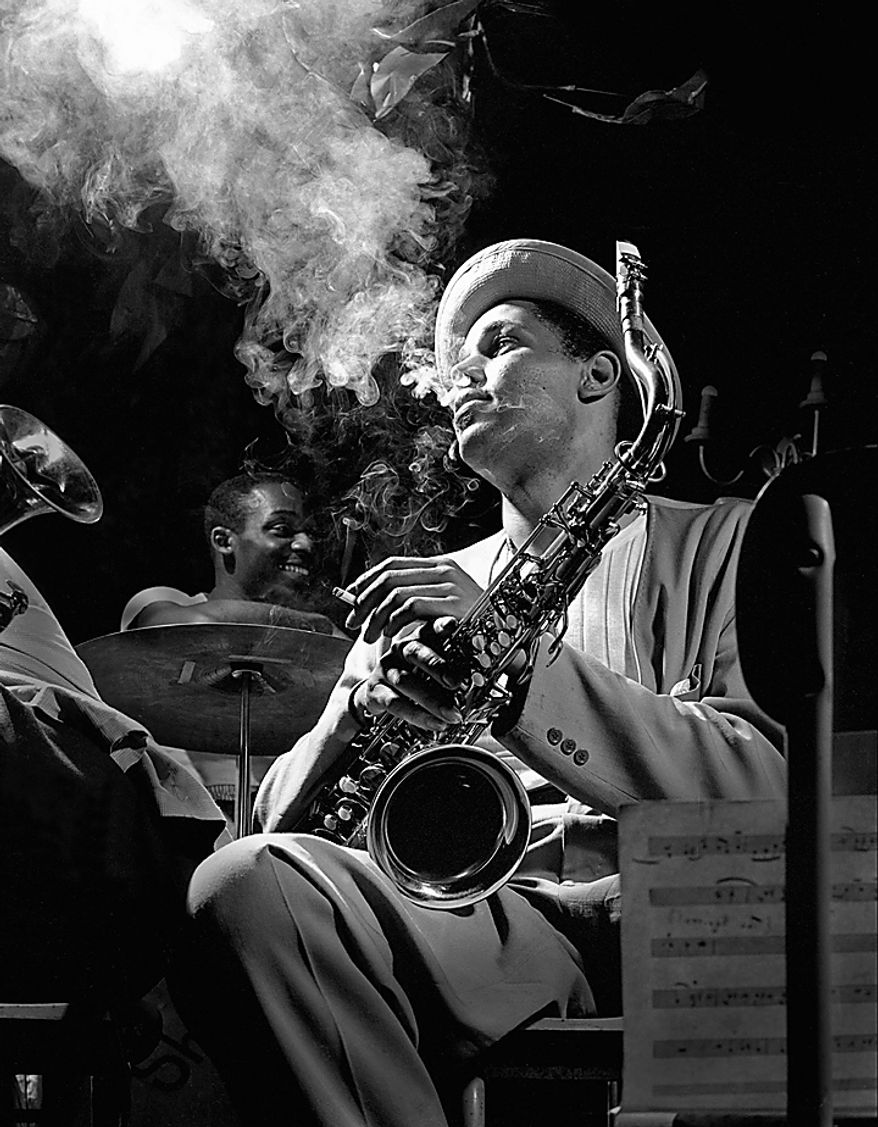 This 1948 file photo released by Herman Leonard Photography, shows tenor saxophonist Dexter Gordon photographed by Herman Leonard, with Gordon enveloped in his cigarette smoke at the Royal Roost in New York. Mr. Leonard, famous for his smoky, backlighted black-and-white photos of such greats as Billie Holiday, Duke Ellington, Charlie Parker, Louis Armstrong, Miles Davis and Frank Sinatra, died Saturday, Aug. 14, 2010, at Cedars-Sinai Medical Center in Los Angeles, family spokeswoman Geraldine Baum said. He was 87. (AP Photo/Herman Leonard Photography, LLC., CTSIMAGES, File)