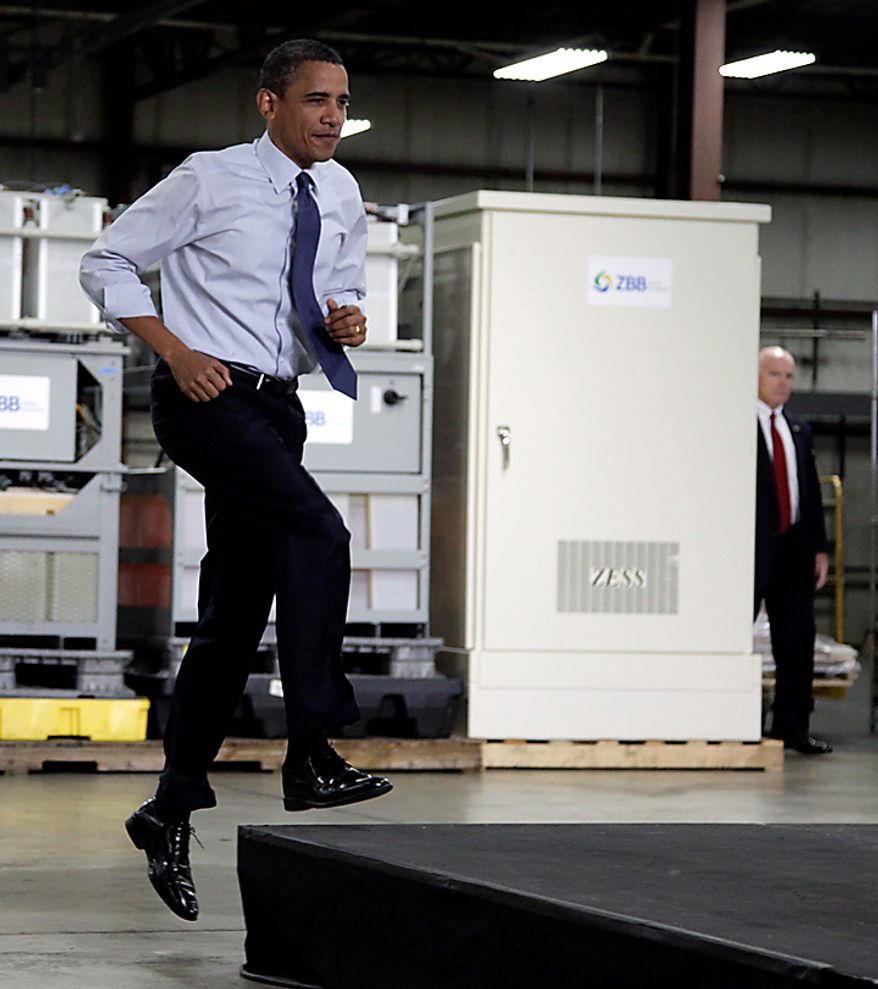 President Obama leaps onto the stage to speak at the ZBB Manufacturing Facility in Menomonee Falls, Wis., Monday, Aug. 16, 2010. (AP Photo/Carolyn Kaster)