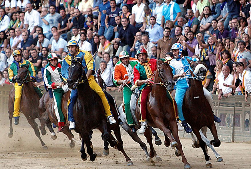 "Luigi Bruschelli ""Trecciolino"" on  Istriceddu, who represents the Tartuca neighborhood, third from left, on his way to win the Palio, the famous break-neck bareback horse race around Piazza del Campo, Siena's main piazza, Italy, Monday, Aug. 16, 2010. The annual Palio pits Siena neighborhoods against one another and its a major tourist draw for this Tuscan city. Each neighborhood puts up a horse and rider to race three times around the slippery, dirt covered cobblestone track. (AP Photo/Paolo Lazzeroni)"