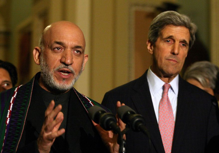 **FILE** Afghan President Hamid Karzai (left) and Sen. John Kerry (The Washington Times)