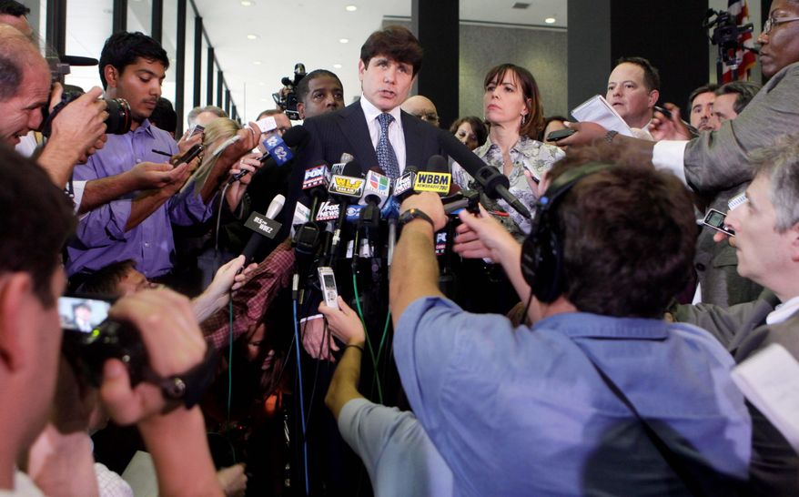 Former Illinois Gov. Rod R. Blagojevich talks defiantly to the news media at the federal court building in Chicago on Tuesday, with wife Patti next to him, after being convicted on one felony count of lying to the FBI. But prosecutors said they would retry him on the 23 other corruption and fraud charges. (Associated Press)