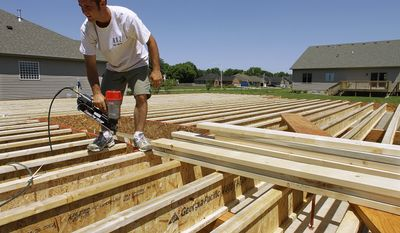 Ryan Turner works at a new home under construction in Springfield, Ill., on June 30, 2010. (AP Photo/Seth Perlman)