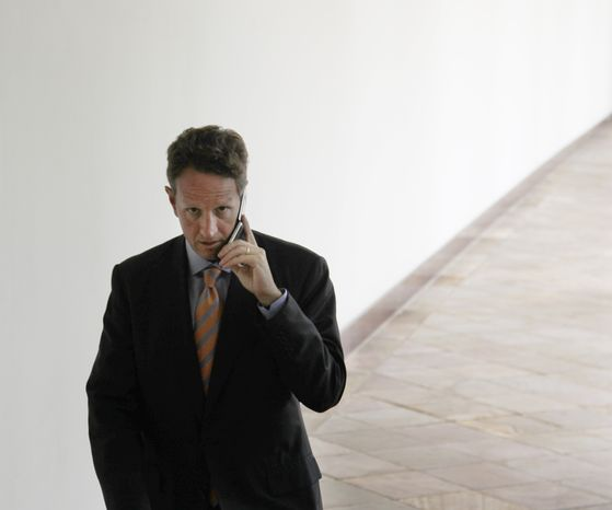 Treasury Secretary Timothy F. Geithner talks on his cell phone as he walks towards the West Wing of the White House in Washington on Tuesday, July 27, 2010. (AP Photo/Pablo Martinez Monsivais)