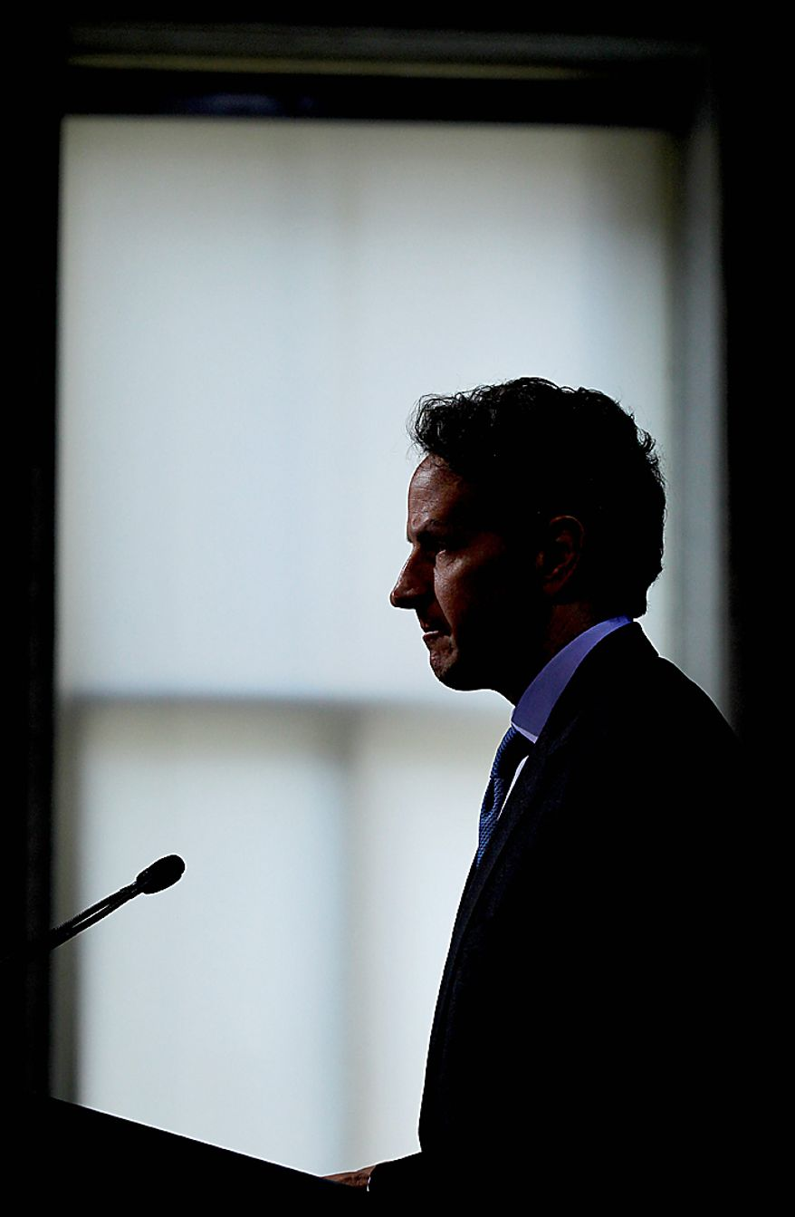 Treasury Secretary Timothy Geithner is silhouetted as he speaks at a Conference on the Future of Housing Finance, Tuesday, Aug. 17, 2010, at the Treasury Department in Washington. (AP Photo/Pablo Martinez Monsivais)