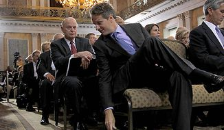 Treasury Secretary Timothy Geithner puts down his notes as he hosted the Conference on the Future of Housing Finance, Tuesday, Aug. 17, 2010, at the Treasury Department in Washington,. Sitting behind Geithner is Alex Pollock from the American Enterprise Institute. (AP Photo/Pablo Martinez Monsivais)