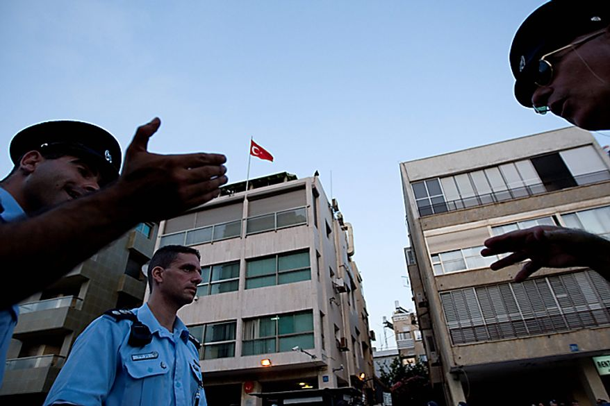 Israeli Police officers are seen in front of the Turkish Embassy in Tel Aviv, Israel, Tuesday, Aug. 17, 2010. A Palestinian took hostages in the Turkish Embassy in Tel Aviv Tuesday after shots were fired outside, Israeli police and a Foreign Ministry official said, in an incident that appeared to have only an indirect link to recent tensions between the two countries. (AP Photo/Ariel Schalit)