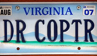 A license plate belonging to Dr. David Nichols sits inside his airplane hanger in Topping, Va., Monday, Aug. 9, 2010. (AP Photo/Richmond Times-Dispatch, Bob Brown)