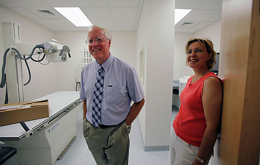 Dr. David Nichols, left, and Physician's Assistant Inez Pruitt smile as they check out the X-Ray room inside the new Tangier Island Health Clinic on Tangier Island, Va. Monday, Aug. 9, 2010. The clinic is scheduled to open on Aug. 29. Dr.  Nichols, who has been flying to Tangier to care for the residents for 30 years, has been diagnosed with terminal cancer. (AP Photo/Richmond Times-Dispatch, Bob Brown)
