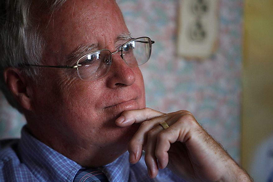 Dr. David Nichols, talks with visitors as he sits in the old Health Clinic on Tangier Island, Va., Monday, Aug. 9, 2010. A brand new clinic is scheduled to open on Aug. 29. Dr. Nichols, who has been flying to Tangier to care for the residents for 30 years, has been diagnosed with terminal cancer. (AP Photo/Richmond Times-Dispatch, Bob Brown)