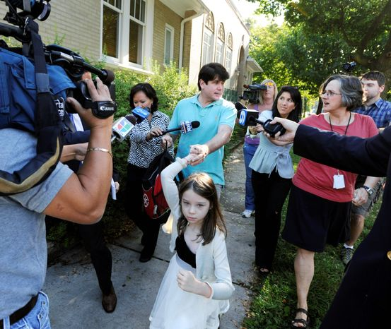ASSOCIATED PRESS Former Illinois Gov. Rod R. Blagojevich talks with reporters as he leaves his home with daughter Annie on Wednesday. The failure to win conviction on more charges in Blagojevich's case is another setback in a string of recent corruption cases.