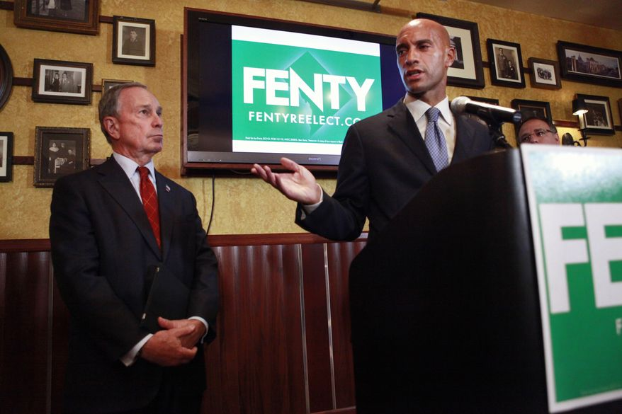 ASSOCIATED PRESS New York City Mayor Michael Bloomberg, left, listens to Washington Mayor Adrian Fenty, after Bloomberg announced his endorsement of Fenty's second term, Tuesday, Aug. 17, 2010, in Washington.