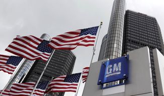 **FILE** This photo from April 21, 2009, shows American flags flying outside General Motors' world headquarters in Detroit. (Associated Press)