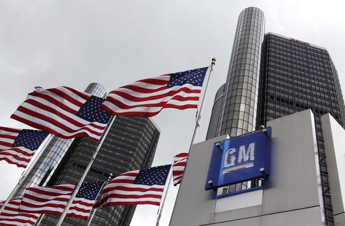**FILE** This photo from April 21, 2009, shows American flags flying outside General Motors' world headquarters in D