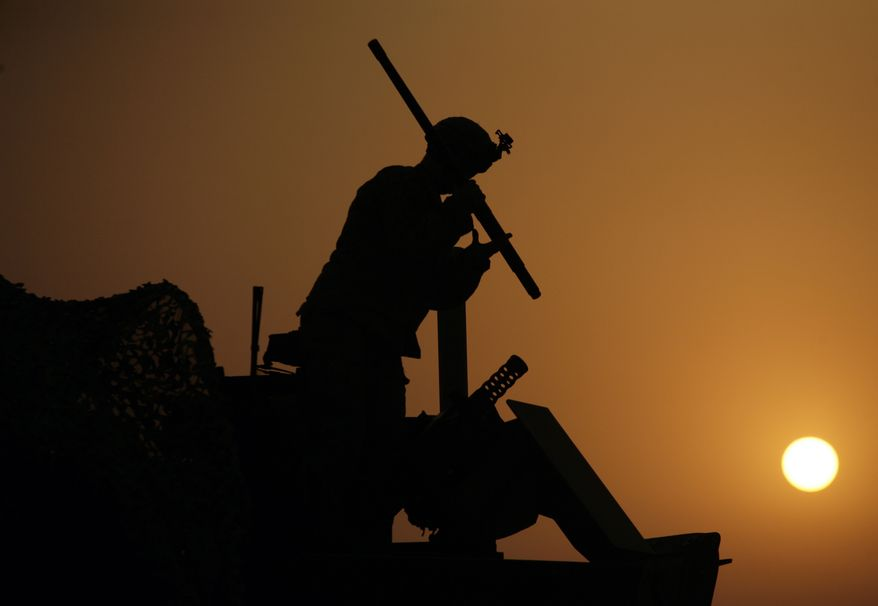 In this Aug. 16, 2010 photo, a U.S Army soldier dismantles a machine gun mounted on his Stryker armored vehicle immediately after crossing the border from Iraq into Kuwait. The U.S. Army's 4th Battalion, 9th Infantry Regiment, part of the 4th Brigade, 2nd Infantry Division, are the last combat brigade to leave Iraq as part of the drawdown of U.S. forces. (AP Photo/ Maya Alleruzzo)