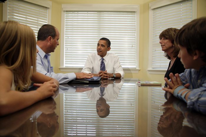 President Obama meets with the Weithman family -- (from left) Rachel, 9; Joe; Rhonda; and Josh, 11 -- on Wednesday, Aug. 18, 2010, in Columbus, Ohio. (AP Photo/Carolyn Kaster)