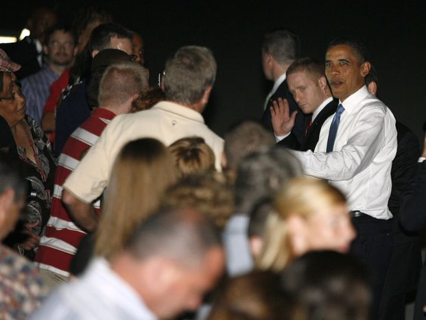 President Obama arrives at Port Columbus International Airport on Tuesday, Aug. 17, 2010, in Columbus, Ohio. He will meet with families on Wednesday to discuss the economy. (AP Photo/Mike Munden)