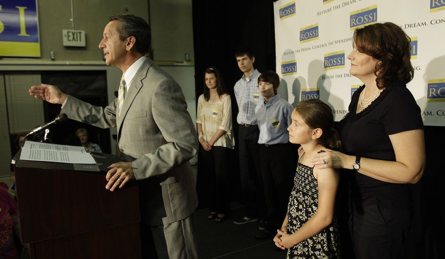 Republican senatorial candidate Dino Rossi talks to supporters and reporters as his wife, Terry (right), and their children, (from second from left) Juliauna, Jake, Joseph and Jillian, look on, on Tuesday, Aug. 17, 2010, in Bellevue, Wash., on Washington state's primary election day. (AP Photo/Ted S. Warren)