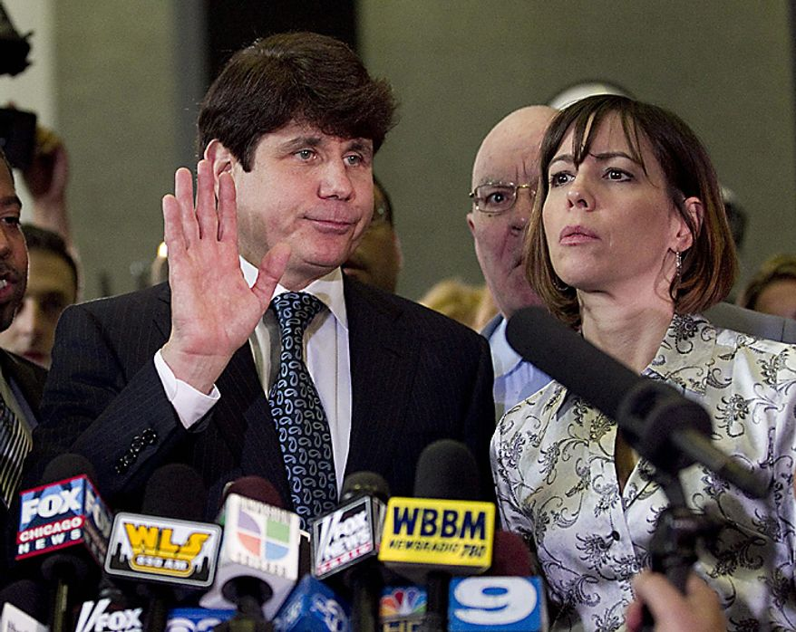 Former Illinois Gov. Rod Blagojevich (L), with his wife Patti, talks to reporters after being found guilty on one count in his 24 count federal corruption indictment in Chicago on August 17, 2010. Blagojevich was found guilty of lying to federal agents, but the judge said he intended to declare a mistrial on the other 23 more serious counts.     UPI/Brian Kersey