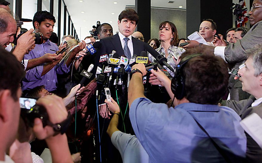 Former Illinois Gov. Rod Blagojevich talks to the media at the Federal Court building, Tuesday, Aug. 17, 2010, in Chicago, next to his wife Patti. (AP Photo/Kiichiro Sato)