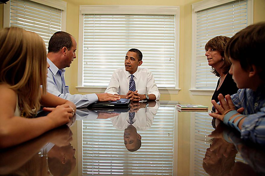 President Barack Obama meets with the Weithman family, from left, Rachel, 9, Joe, Rhonda and Josh, 11, Wednesday, Aug. 18, 2010, in Columbus, Ohio. (AP Photo/Carolyn Kaster)