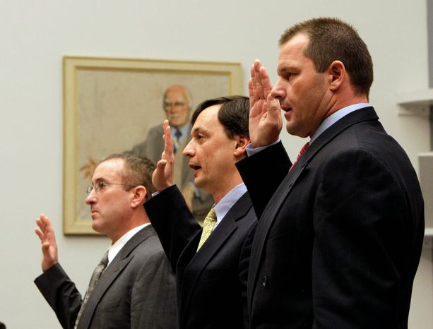 ASSOCIATED PRESS From right, former New York Yankees pitcher Roger Clemens, lawyer Charles Scheeler and his former personal trainer Brian McNamee, are sworn-in before Mr. Clemens' hearing on drug use in 20