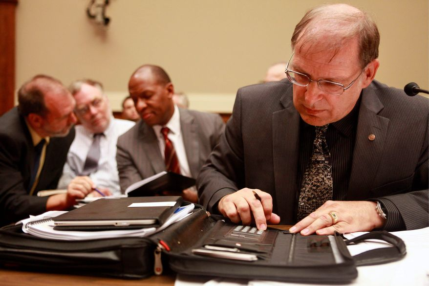 ASSOCIATED PRESS PHOTOGRAPHS Bill Lehr, (above) a federal government scientist, calculates some figures related to the Gulf of Mexico oil spill while testifying on Capitol Hill during a House energy and environment subcommittee hearing.