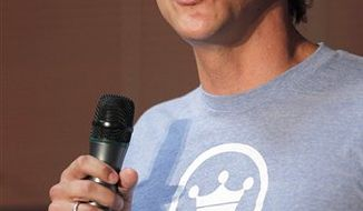 """Facebook CEO Mark Zuckerberg, right, talks with employees before announcing the social network site's new localization services called """"Places"""" during a press conference in Palo Alto, Calif., on Wednesday, Aug. 18, 2010. (AP Photo/Tony Avelar)"""