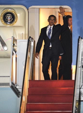 President Obama waves as he exits Air Force One at Andrews Air Force Base, Md., Wednesday, Aug. 18, 2010. (AP Photo/Cliff Owen)