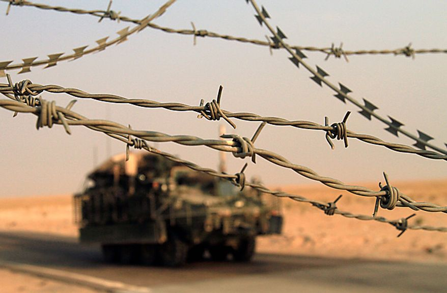 A U.S. Army Stryker armored vehicle crosses the border from Iraq into Kuwait Wednesday, Aug. 18, 2010. The U.S. Army's 4th Brigade, 2nd Infantry Division is the last combat brigade to leave Iraq as part of the drawdown of U.S. forces. (AP Photo/ Maya Alleruzzo)