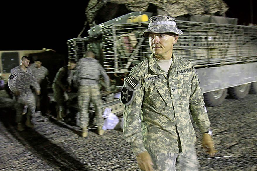 U.S. Army Col. John Norris, commander of the 4th Stryker Brigade Combat Team, 2nd Infantry Division, waits for the last Stryker armored vehicle carrying his soldiers to arrive after crossing into Kuwait from Iraq, Thursday, Aug. 19, 2010. The U.S. Army's 4th Brigade, 2nd Infantry Division is the last combat brigade to leave Iraq as part of the drawdown of U.S. forces.  (AP Photo/ Maya Alleruzzo)