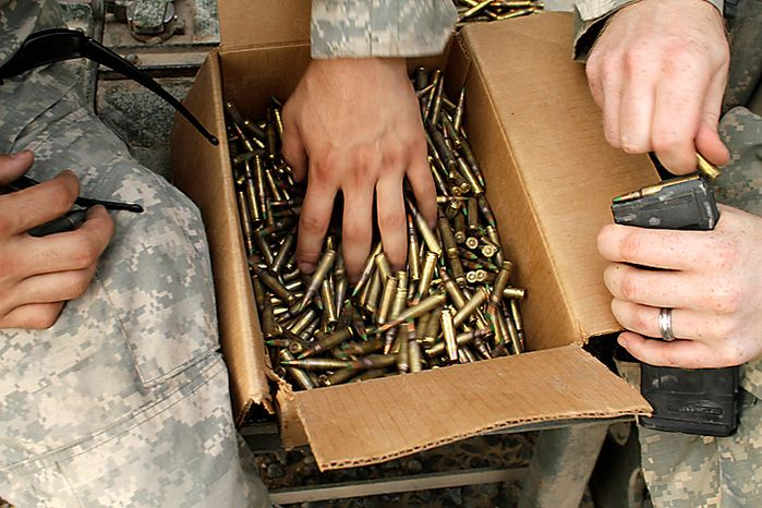 **FILE** U.S. Army soldiers from 4th Battalion, 9th Infantry Regiment count ammunition Aug. 16, 2010, before turning it in after crossing the border from Iraq into Kuwait. (Associated Press/Maya Alleruzzo)