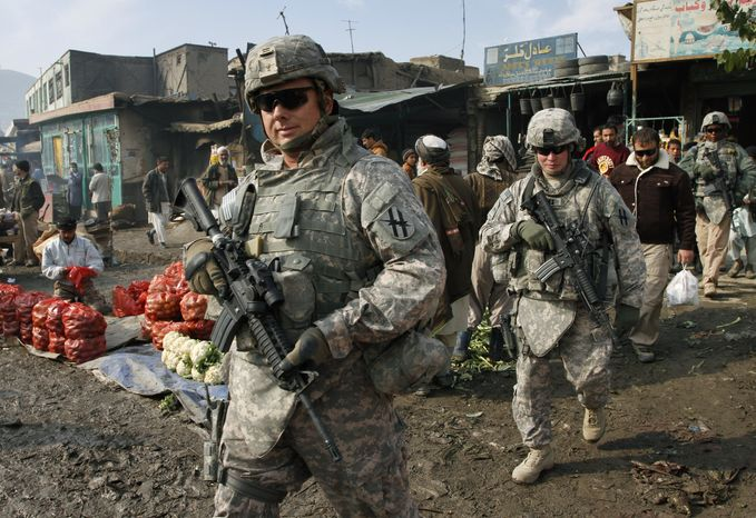 In this Dec. 2, 2009, file photo, U.S. soldiers patrol through the heart of Kabul, Afghanistan. A majority of Americans see no end in sight in Afghanistan, and nearly six in 10 oppose the nine-year-old war as President Obama sends tens of thousands more troops to the fight, according to a new Associated Press-GfK poll. (AP Photo/Musadeq Sadeq, File)