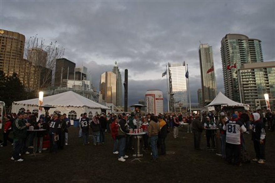 FILE - This Dec. 3, 2009, file photo shows fans tailgating before an NFL football game between the Buffalo Bills and the New York Jets in Toronto. In announcing a $78.5 million deal to have the Buffalo Bills play eight games in Toronto, the late Ted Rogers two years ago envisioned full houses and fans lining up for blocks to buy tickets.  (AP Photo/Mike Groll)
