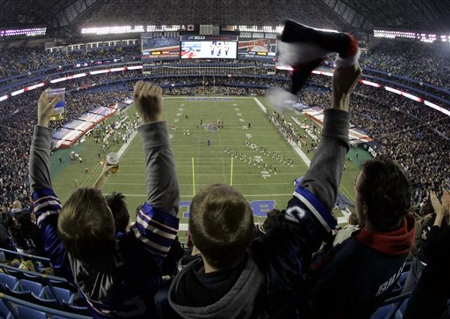 FILE - This Dec. 7, 2008, file photo shows Buffalo Bills fans cheering before the Buffalo Bills NFL football game against the Miami Dolphins  at the Rogers Centre in Toronto.  In announcing a $78.5 million deal to have the Buffalo Bills play eight games in Toronto, the late Ted Rogers two years ago envisioned full houses and fans lining up for blocks to buy tickets. (AP Photo/David Duprey, File)