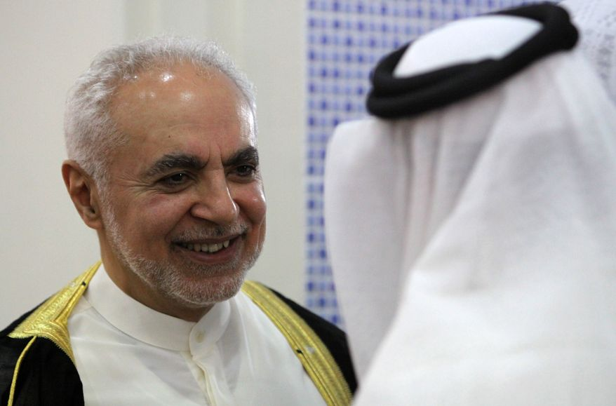 Imam Feisal Abdul Rauf, left, executive director of the Cordoba Initiative, greets an unidentified worshiper inside a Muharraq, Bahrain, mosque after leading midday prayers Friday, Aug. 20, 2010. Imam Rauf, who is leading plans for an Islamic center near the site of the Sept. 11 attacks on New York, is on a U.S.-funded outreach tour to Bahrain, Qatar and the United Arab Emirates to talk about religious tolerance in America. (AP Photo/Hasan Jamali)