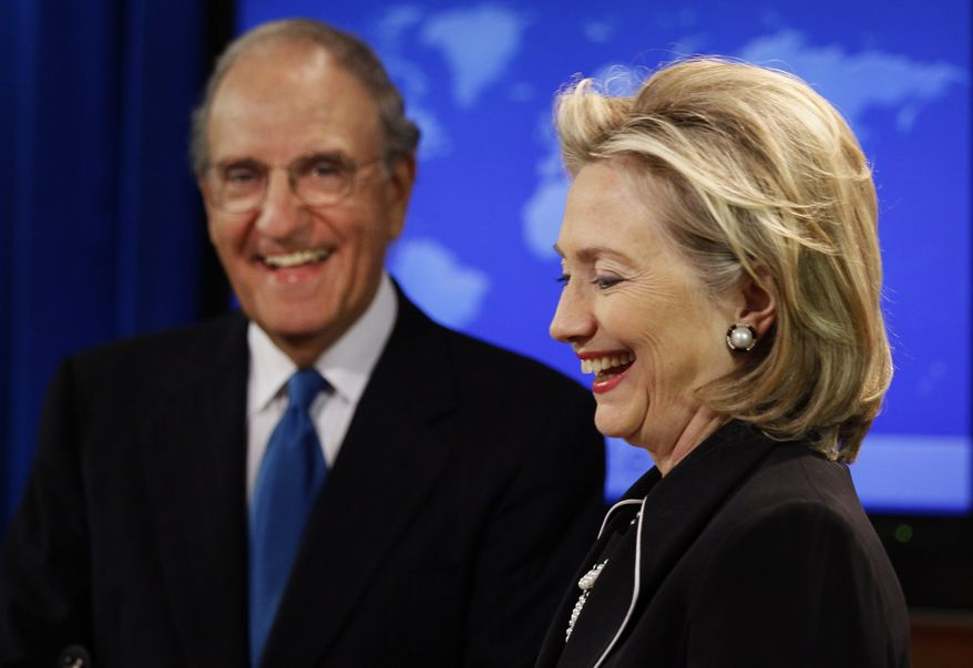 Secretary of State Hillary Rodham Clinton, right, and special Mideast peace envoy George Mitchell, smile as they talk with the media about Mideast peace talks, Friday, Aug. 20, 2010, at the State Department in Washington. Israel and the Palestinians have agreed to resume their long-stalled direct negotiations in Washington early next month, Mrs. Clinton said Friday, with a goal of two sovereign states existing side by side in peace. (AP Photo/Alex Brandon)