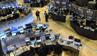 In this photograph taken on Aug. 19, 2010, traders work on the floor of the New York Stock Exchange, in New York. Stock futures are falling as investors continue a sell-off Friday, Aug. 20, that began a day earlier over worries about the pace of economic recovery. (AP Photo/Henny Ray Abrams)