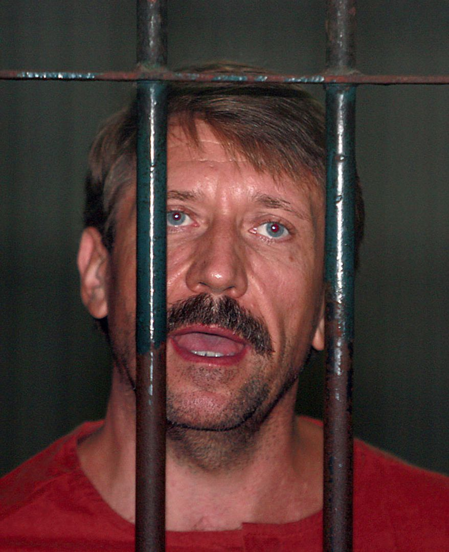Viktor Bout, a suspected Russian arms dealer, speaks with reporters from inside the court cell at the criminal court in Bangkok, Thailand, Friday, Aug. 20, 2010. An appeals court in Thailand ordered Mr. Bout's extradition to the United States. (AP Photo/Apichart Weerawong)