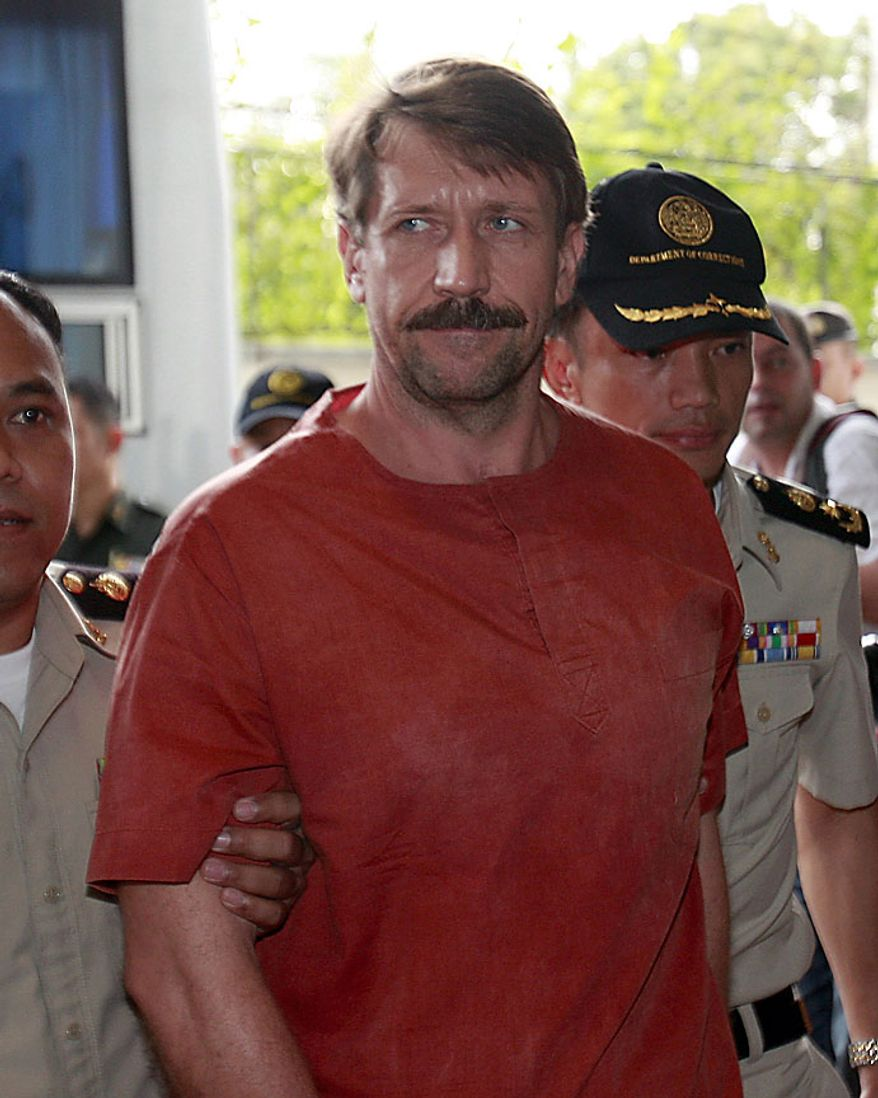 "Viktor Bout, a suspected Russian arms dealer, is escorted by prison officials as he arrives at the criminal court in Bangkok, Thailand Friday, Aug. 20, 2010. An appeals court granted a U.S. request to extradite the elusive Russian businessman dubbed ""The Merchant of Death."" (AP Photo/Apichart Weerawong)"