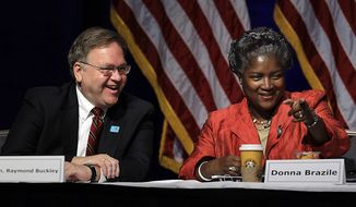 Democratic National Committee officers Raymond Buckley, left, and Donna Brazile take part in the DNC's summer meeting, Friday, Aug. 20, 2010, in St. Louis. (AP Photo/Jeff Roberson)