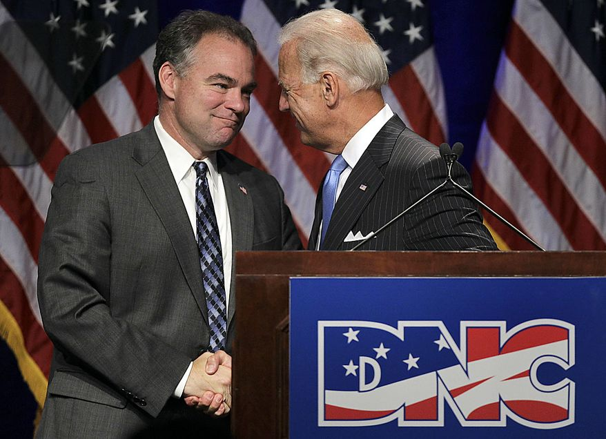 Vice President Joe Biden shakes hands with Democratic National Committee Chairman Tim Kaine during the summer meeting of the Democratic National Committee, Friday, Aug. 20, 2010, in St. Louis. (AP Photo/Jeff Roberson)