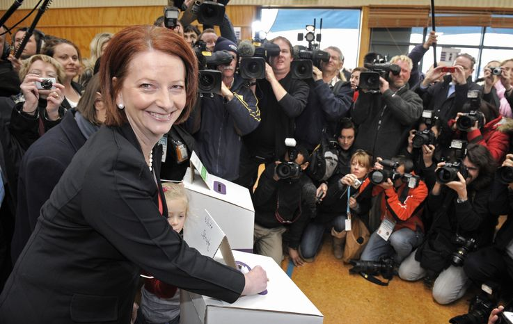 Australian Prime Minister Julia Gillard of the Federal Labor Party casts her vote at the Seabrook Primary School in Melbourne, Australia, on Saturday, Aug. 21, 2010. (AP Photo/Mark Graham)