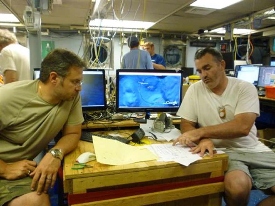 A June 2010 photo provided by the Woods Hole Oceanographic Institution shows Chief Scientist Rich Camilli, left, a WHOI environmental engineer, and co-principal investigator Chris Reddy, a WHOI marine chemist and oil spill expert, aboard the research vessel Endeavor in the Gulf of Mexico. Camilli is the chief author of a study released Thursday, Aug. 19, 2010 in which scientists report the first conclusive evidence of an underwater plume from the BP spill.  (AP Photo/Woods Hole Oceanographic Institution, Cameron McIntyre)