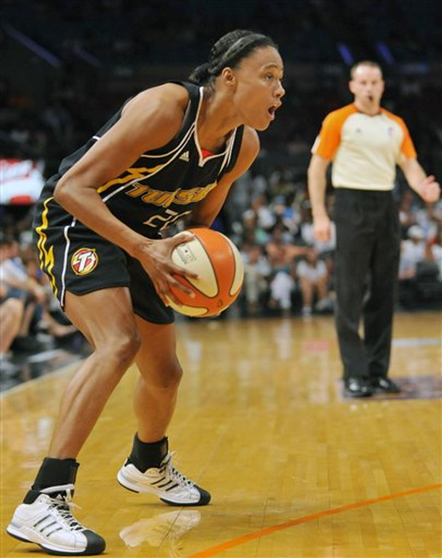 Tulsa Shock's Marion Jones drives by New York Liberty's Tiffany Jackson, left, during the first half of a WNBA basketball game Thursday, Aug. 19, 2010 in New York. (AP Photo/Stephen Chernin)