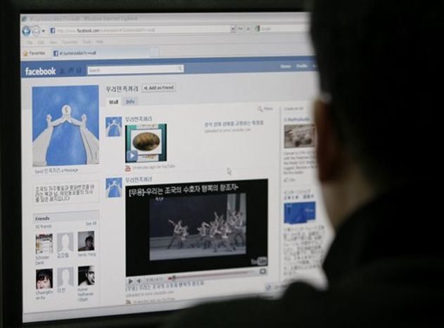 "A South Korean journalist looks at a computer screen showing an alleged North Korean Facebook account which carries content condemning ""warmongers"" South Korea and the U.S. in Seoul, South Korea, Friday, Aug. 20, 2010.  Reclusive North Korea appears to have added Facebook to the list of social network services it has recently joined to ramp up its propaganda war against South Korea and the U.S. (AP Photo"