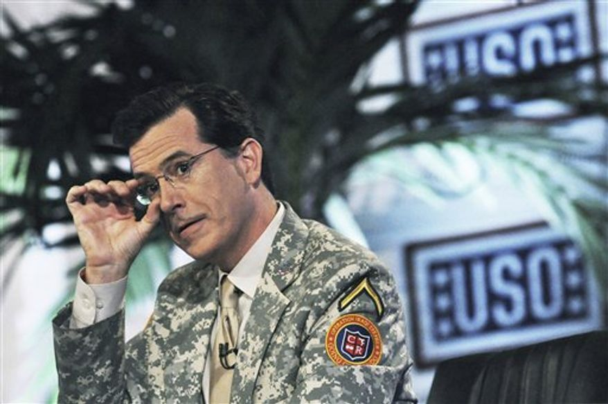 "In this June 7, 2009, file photo originally released by the USO, comedian Stephen Colbert, from the Comedy Central television program, ""The Colbert Report,"" us shown during a taping the first of four shows in front of U.S. soldiers at Camp Victory in Baghdad, Iraq. COLBERT will broadcast two special episodes of Comedy Central's ""The Colbert Report"" to celebrate the end of combat operations in Iraq and to honor returning troops.(AP Photo/USO, Steve Manuel, file)"