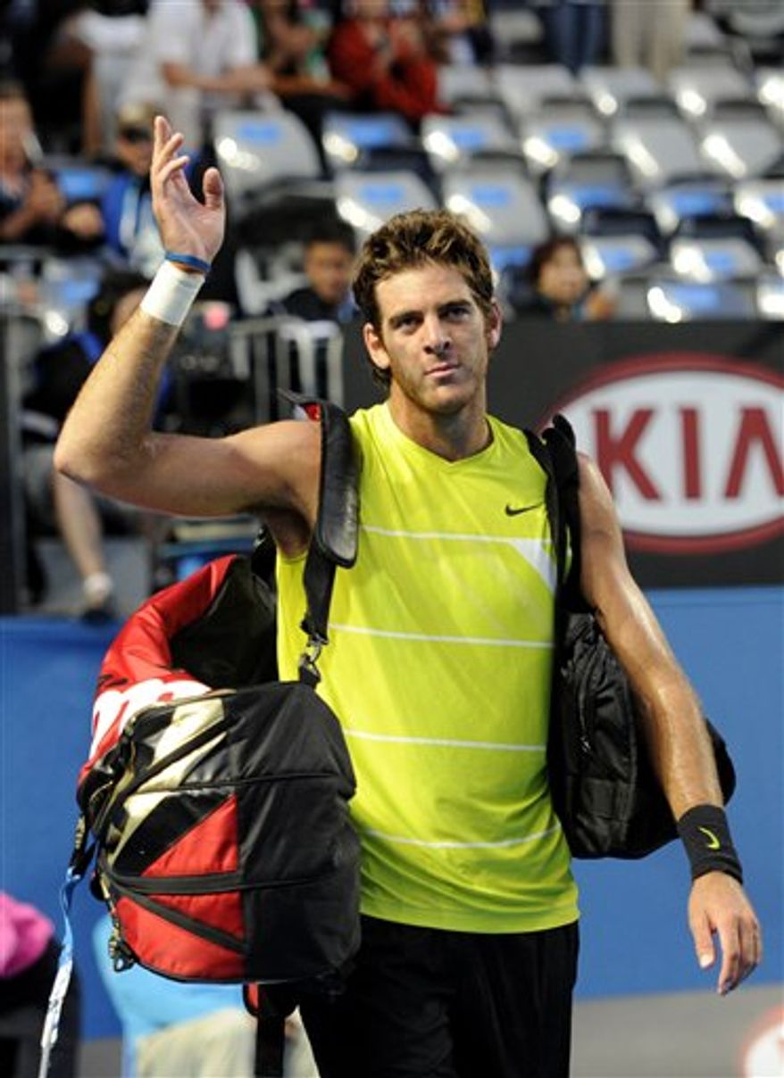 FILE - In this Jan. 24, 2010, file photo, Juan Martin del Potro of Argentina, waves as he leaves the court  after his loss to Marin Cilic of Croatia in a fourth round match  at the Australian Open tennis championship in Melbourne, Australia. A person familiar with Juan Martin del Potro's plans tells The Associated Press that the 2009 U.S. Open champion will not defend his title at the year's last Grand Slam tournament.  The person spoke to the AP on Saturday, Aug. 21, 2010, on condition of anonymity because an official announcement has not been made. (AP Photo/Andy Wong, File)